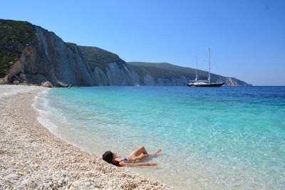 A lady lying on the fteri beach